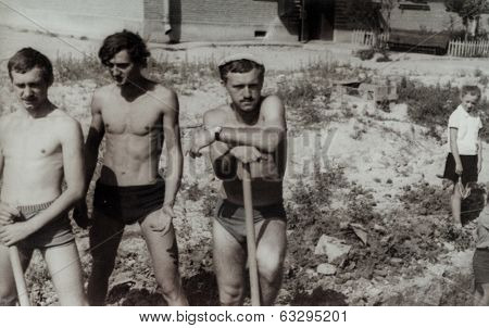 RUSSIA, CIRCA 1970's: Vintage photo of three construction workers posing with shovels