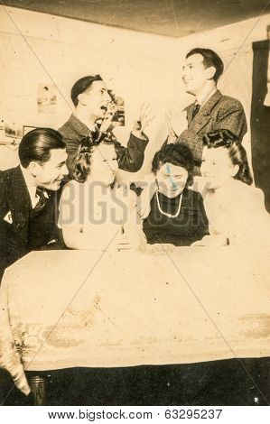 LODZ, POLAND CIRCA 1940's: Vintage photo of young people enjoying a party