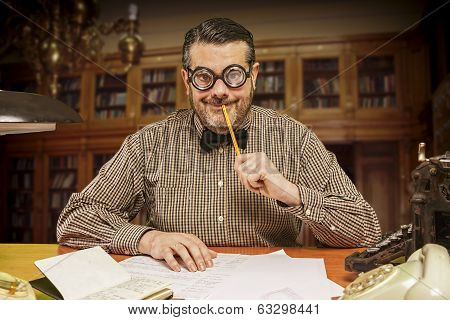 Pensive Office Employee With A Pencil In His Mouth Looking Up In The 1960S