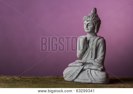 Statue figurine of meditating Gautama Buddha in sitting lotus position