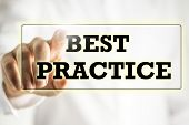 stock photo of  practices  - Words Best practice on a virtual interface in a navigation bar with a businessman touching it with his finger from behind - JPG