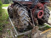 pic of mountain chain  - Closeup of wheels of the tractor chain forest in the mountains - JPG