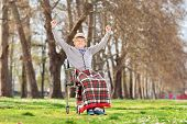 Elderly gentleman gesturing happiness outdoors