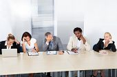 image of officer  - Group Of Tired Corporate Personnel Officers In A Row - JPG