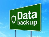 Information concept: Data Backup and Contoured Shield on road sign background