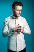 stock photo of bow tie hair  - Stylish businessman in white shirt and with bow - JPG