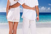 Closeup image of woman and man wearing white clothes enjoying seascape, body part, holding hands, su