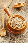 stock photo of buckwheat  - Buckwheat porridge in the ceramic pot on the table - JPG