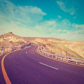 stock photo of golan-heights  - Asphalt Road on the Golan Heights in Israel Photo Filter - JPG