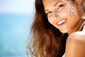 pic of sun tan lotion  - Suntan Lotion Woman Applying Sunscreen Solar Cream - JPG