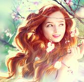 image of tree-flower  - Spring beauty girl with long red blowing hair outdoors - JPG