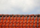 Roof Top With Red Tiles And Clouds