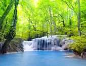 Tropical waterfall in Thailand, nature photography. Fresh water mountain river in wild green jungle