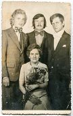 LODZ, POLAND, CIRCA 1950's: Vintage photo of newlyweds with bestmen