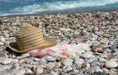 Hat with pareo on the beach poster