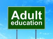 Adult Education on road sign background