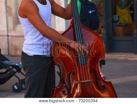 Street Musician Plays Double Bass