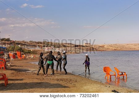 Vacationers In The Mineral Mud Of The Dead Sea