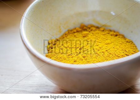 Yellow Curry Powder In  Ceramic Bowl