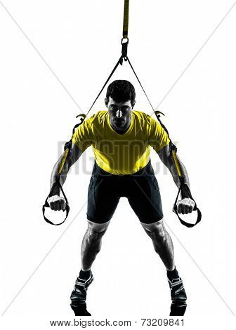 one  man exercising suspension training trx on white background