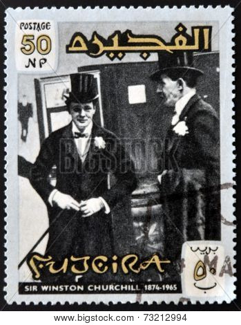 FUJERIA - CIRCA 1966: A stamp printed in Fujeira shows image of sir winston churchil 1874-1965