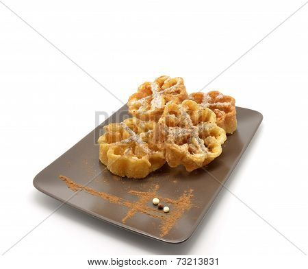 plate of flores fritas or flores de pascua typical Easter dessert Spain