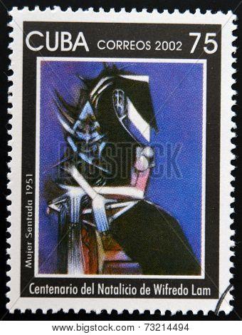 CUBA - CIRCA 2002: A stamp printed in cuba shows woman sitting by Wifredo Lam circa 2002