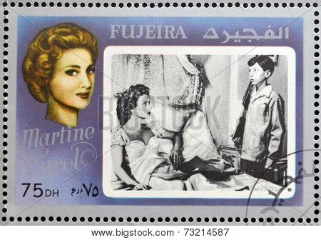 FUJEIRA - CIRCA 1972 : stamp printed in Fujeira shows french actress Martine Carol circa 1972