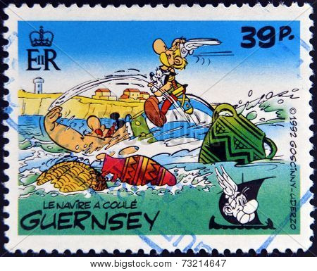 GUERNSEY - CIRCA 1992 : stamp printed in Guernsey shows the ship sinks belonging to the comic Asteri