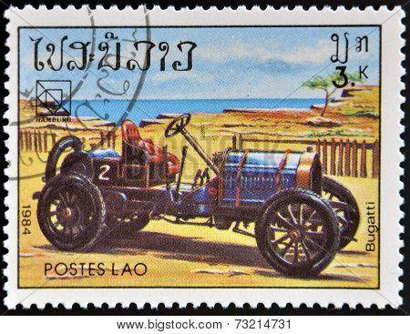 LAOS - CIRCA 1984: A stamp printed in Laos shows retro car Bugatti circa 1984.