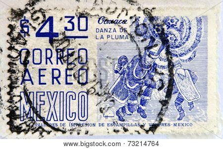 MEXICO - CIRCA 1950: a stamp printed in Mexico shows feather dance Oaxaca circa 1950