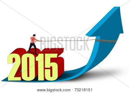 Businessman With Upward Arrow And Number 2015