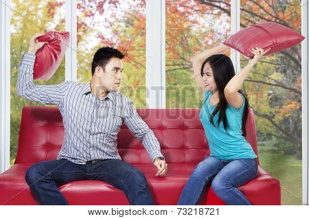 Couple Hit Each Other With Pillow