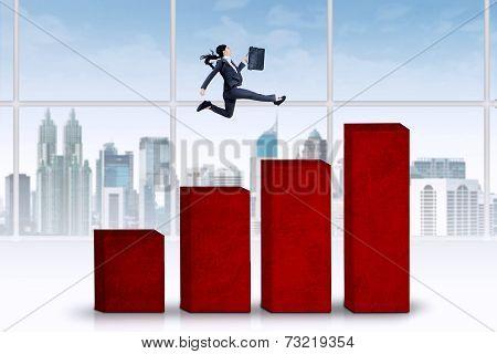 Female Entrepreneur Running Over Chart