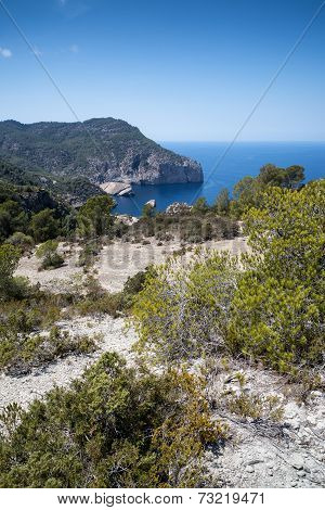 Landscape Image Of S'aguila Bay Cove On Mediterranean Island Of Ibiza