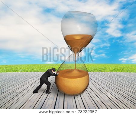 Businessman Pushing Tilt Sandglass