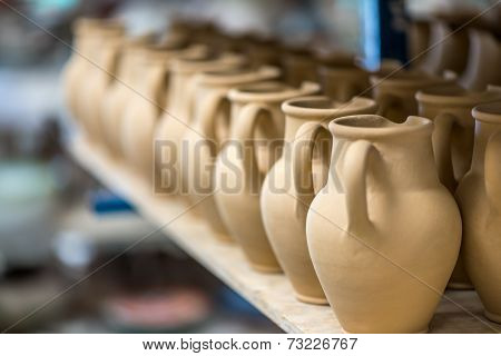 Ceramic Dishware In Pottery Workshop