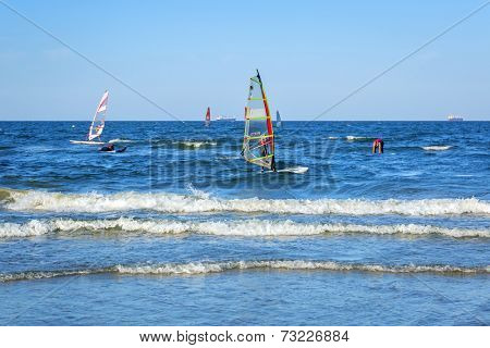 GDANSK, POLAND - 17 SEPTEMBER 2014: Windsurfing on Baltic sea in Sopot, Poland. Windsurfing is very popular water sport in Poland. Sopot was the host of Windsurfing World Championship 2014.