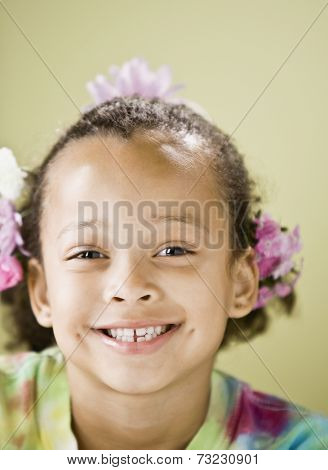 Close up of Mixed Race girl smiling