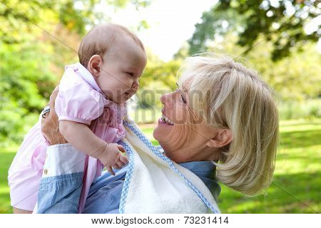Happy Grandmother With Cute Baby