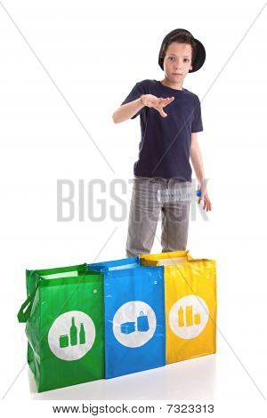 Boy Putting A Plastic Bottle To Recycle
