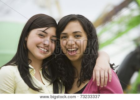 Multi-ethnic teenaged girls hugging