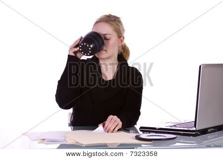 Isolated Businesswoman At Her Desk Working