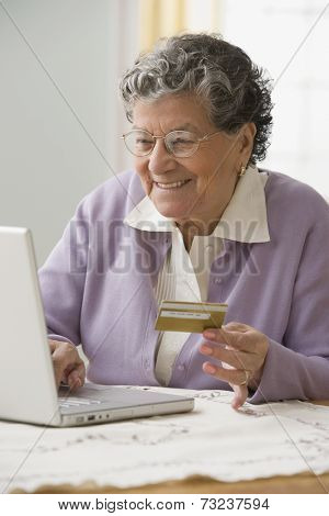 Senior Hispanic woman shopping online