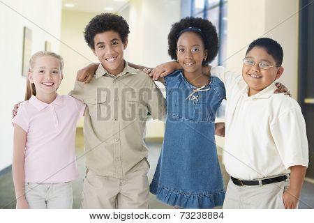 Multi-ethnic children standing arm in arm