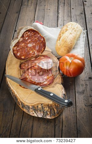 Morcon, A Spanish Sausage With Bread And Tomato