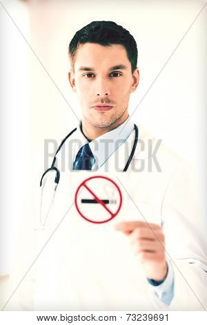 male doctor holding no smoking sign in hands