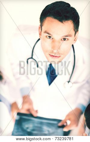 bright picture of male doctor with x-ray