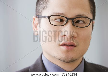 Asian businessman with eyes crossed