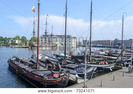 AMSTERDAM - JULY 26: Moored yachts in the harbour on 26 July 2014 in Amsterdam, The Netherlands.